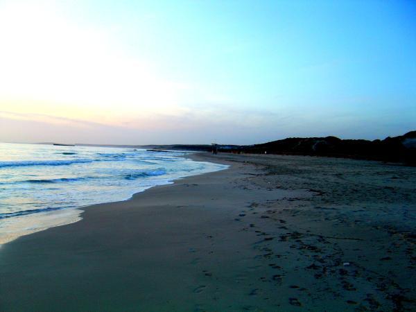 Dónde ver el mejor atardecer en Menorca - Atardecer en la playa de Son Bou